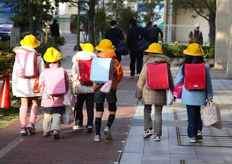 Japanese school children walking to school