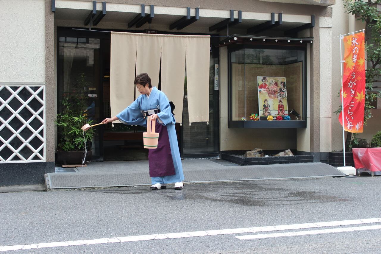 Sprinkling water in Japan to cool the streets