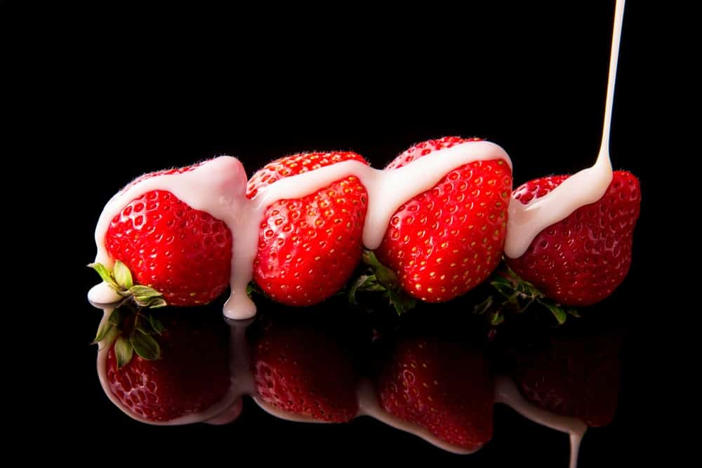 Strawberries covered in a drizzle of condensed milk