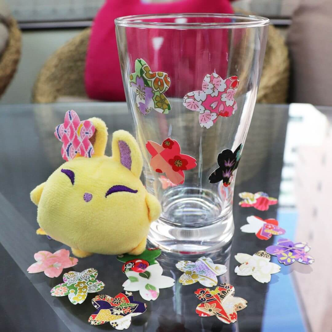 Luna decorates a glass with stickers from ZenPop's April Stationery Pack