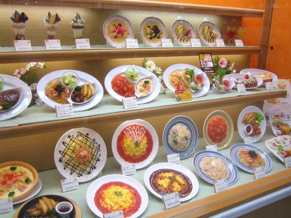 Japanese fake food displayed in a window of a restaurant
